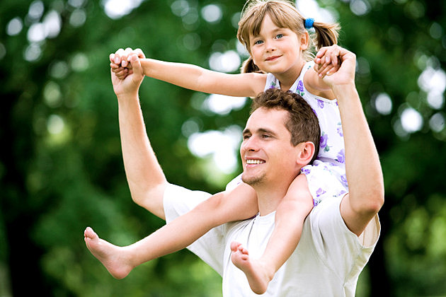 Father Giving Daughter Piggyback Ride
