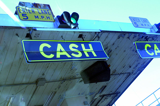 Cash sign at toll booths